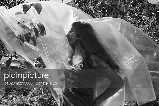 Girl under a plastic foil - p1623m2295006 by Donatella Loi