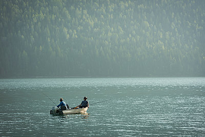 Two fishermen fishing in the river - p1315m2055884 by Wavebreak