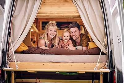 Family relaxing in motor home - p1124m2228986 by Willing-Holtz
