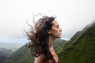 Wind blowing hair of Mixed Race woman - p555m1303828 by Kyle Monk