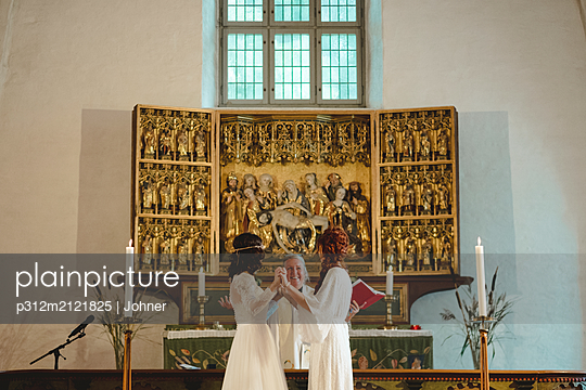 Brides at wedding ceremony - p312m2121825 by Johner