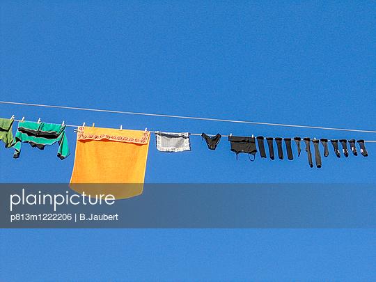 Washing on the line - p813m1222206 by B.Jaubert