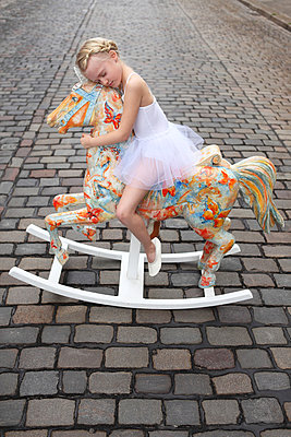 Girl on her rocking horse - p045m853383 by Jasmin Sander