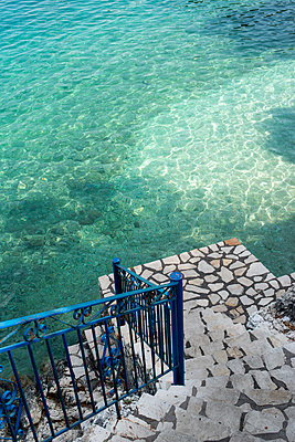 Marble steps lead into the Ionian Sea at Kioni, Ithaca, Greece - p1433m1584111 by Wolf Kettler