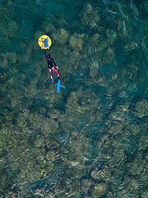 Freedivers with buoy in ocean - p300m2080785 by Konstantin Trubavin