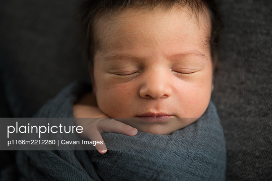 Close Up View of Sleeping Newborn Baby's Face, Lots of Hair - p1166m2212280 by Cavan Images