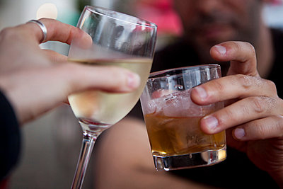 Couple Toasting with White Wine and Whiskey, Close-up View - p669m806297 by Kelly Davidson