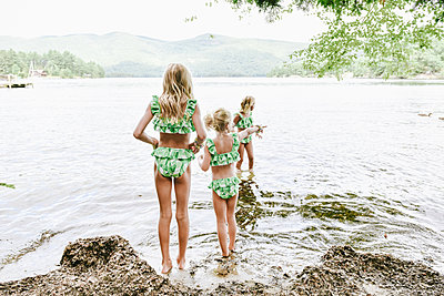 Siblings by the bathing lake - p1086m2149971 by Carrie Marie Burr
