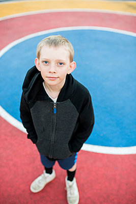 High angle portrait of boy standing at court - p1166m1521034 by Cavan Images