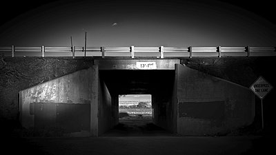 Black & White Distance shot of Interstate Underpass with signgage - p1166m2157037 by Cavan Images
