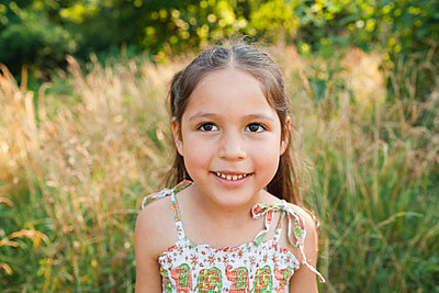 Smiling girl in field - p555m1479745 by Rebecca Drobis