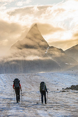 Two climbers en route to climb Mount Loki, Baffin Island. - p1166m2189682 by Cavan Images