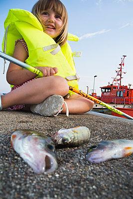 Little girl fishing - p1418m2014920 by Jan Håkan Dahlström