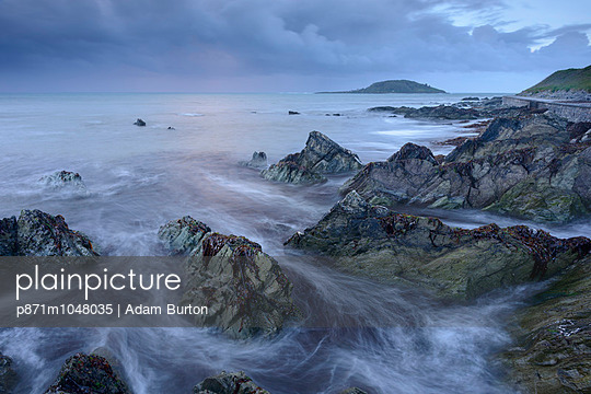 Waves swirl around Hannafore Beach at high tide, Looe, Cornwall, England, United Kingdom, Europe - p871m1048035 by Adam Burton