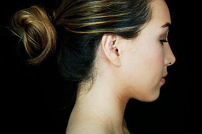 Profile of serious Hispanic woman - p555m1304807 by Peathegee Inc