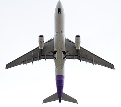 Airplane from below - p719m1511396 by Rudi Sebastian