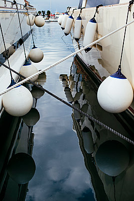 Buoys on boats in Vrsar harbour - p728m2027215 by Peter Nitsch