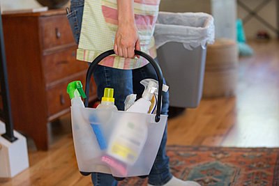Young woman cleaning home with green cleaning products - p924m973842f by heshphoto