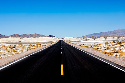 Road Through Mojave Desert - p1489m1573667 by Paul Simcock