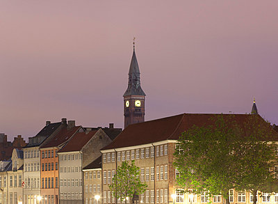 Clock tower overlooking village - p42918603 by Alex Holland