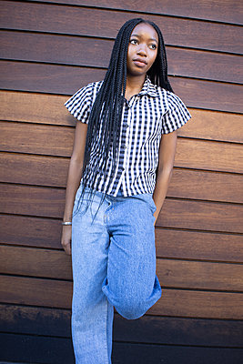 African teenage girl with dreadlocks - p1640m2259894 by Holly & John