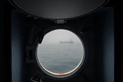 A ship seen through the porthole - p354m1043350 by Andreas Süss