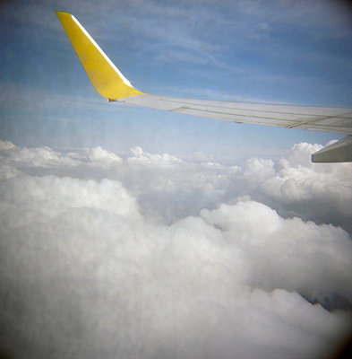 Wing of an airplane in the sky - p4903228 by Sabine Fritsch
