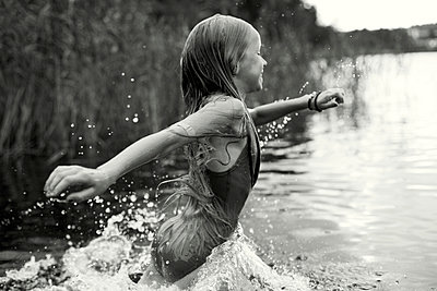 Child bathing in a lake - p972m1056471 by Felix Odell