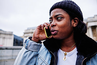 Young Woman Talking On The Phone - p1166m2255359 by Cavan Images