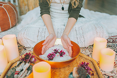 Hands in a salt bowl ceremony at a women's circle - p300m2166337 by Crystal Sing