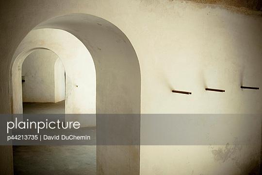 Archways Inside A Building With White Walls; Dakar Senegal - p44213735 by David DuChemin