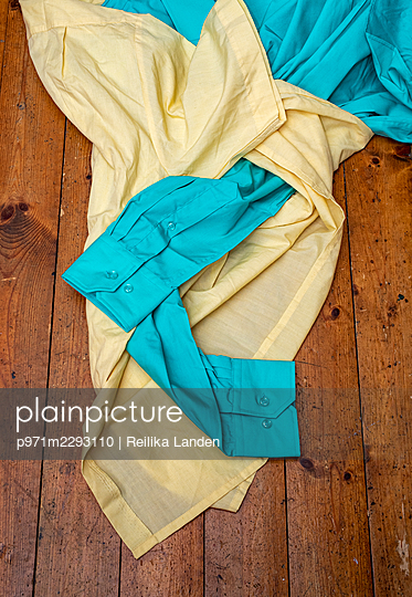 Two shirts on the floor - p971m2293110 by Reilika Landen