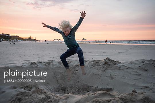 Jumping boy at the beach - p1354m2292923 by Kaiser