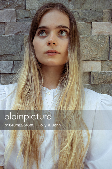Young woman with long blond hair - p1640m2254689 by Holly & John