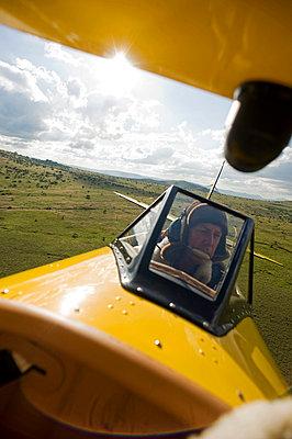 Will Craig flies his 1930s style Waco Classic open cockpit bi-plane for ultimate aerial safaris - p6521168 by John Warburton-Lee