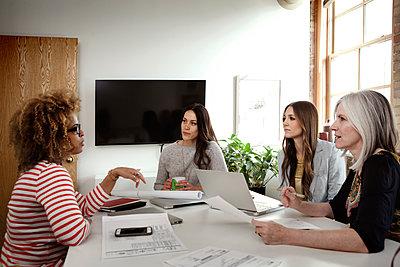 Multi-ethnic businesswomen discussing in board room - p1166m1141464 by Cavan Images