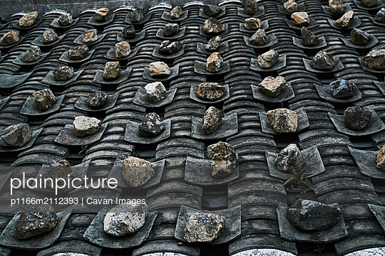 High angle view of old weathered house roof - p1166m2112393 by Cavan Images