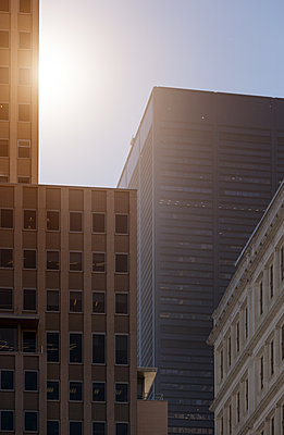 Office buildings with burst of sunlight - p1280m2181948 by Dave Wall
