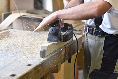 Carpenter working with plane in workshop - p300m1191543 by lyzs