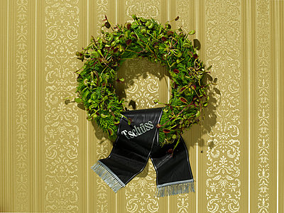 Funeral wreath at the wall - p803m2270190 by Thomas Balzer