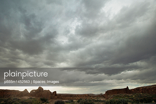 Cloudy sky over rock formations, Chaco Canyon, New Mexico, United States