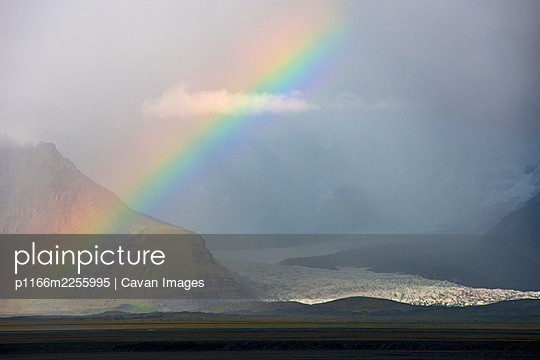 rainbow at SvÌ_nafellsjÌŠkull glacier in south Iceland - p1166m2255995 by Cavan Images