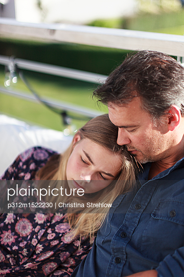Teenage girl with father - p312m1522230 by Christina Strehlow