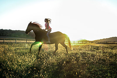 Teenage Girl riding Horse - p1019m1487237 by Stephen Carroll