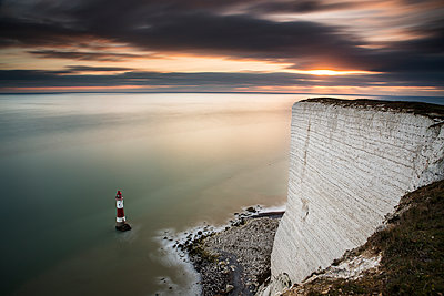 Beachy Head lighthouse at low tide with sunset light - p1516m2158282 by Philip Bedford