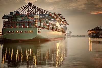 Germany, Hamburg, Container Terminal, Container ship in the evening - p300m981426f by Robert Mandel
