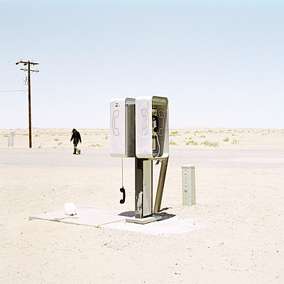 Public telephone receiver off the hook, Death Valley, USA  - p3011455f by fStop