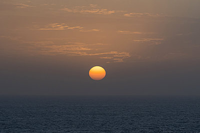Sunset over the sea - p930m2148419 by Ignatio Bravo