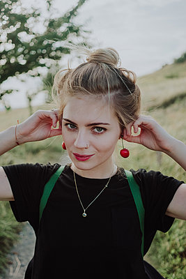 Young woman with cherries as earrings - p1184m1222865 by brabanski