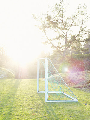 A soccer goal against the light Sweden. - p31217206f by Fredrik Nyman